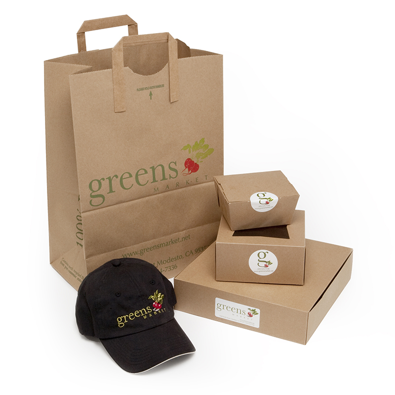 Greens labeled grocery bag, boxes and hat